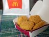 FILE - In this March 4, 2015, file photo, an order of McDonald's Chicken McNuggets is displayed for a photo in Olmsted Falls, Ohio. McDonald's had signaled changes were in store in late 2014, and the company said it was evaluating the cooking procedures and ingredients for its core menu items. McDonald's said it is testing Chicken McNuggets made without artificial additives and fresh beef instead of frozen beef for some burgers.