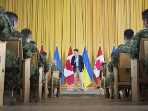 Canadian Prime Minister Justin Trudeau speaks to Canadian troops as he visits the International Peacekeeping and Security Centre near Yavoriv, Ukraine Tuesday July 12, 2016.