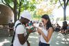 Adrian Thomas and Caitlin Huynh are pictured playing Pokemon Go at Toronto's Jack Layton Ferry Terminal. (ERNEST DOROSZUK, Toronto Sun)