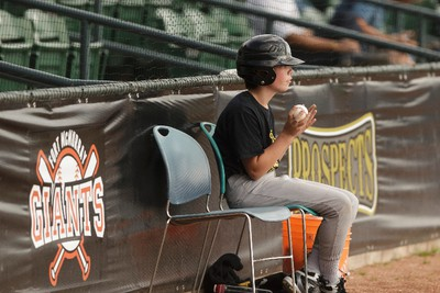 A bat boy waits for the start of a playoff game between the Edmonton Prospects and the Okotoks Dawgs at Telus Field in Edmonton, Alberta on Tuesday, August 2, 2016. Ian Kucerak / Postmedia