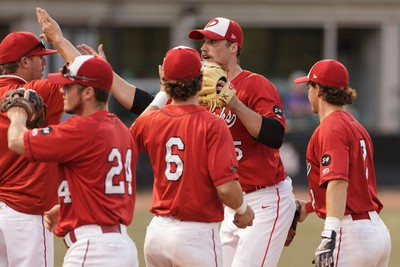 Okotoks players celebrate pitcher Liam Stroud's (second from right) shut out inning during a playoff game between the Edmonton Prospects and the Okotoks Dawgs at Telus Field in Edmonton, Alberta on Tuesday, August 2, 2016. Ian Kucerak / Postmedia