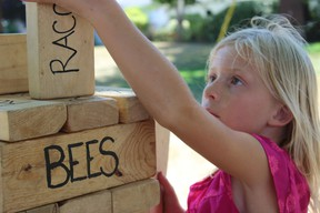 Samantha Reed/The Intelligencer Seven-year-old Ellie Smithers of Kemptville builds a structure with building blocks during one of the activities for the Wild About Wildlife Family Nature Days in Wellington.