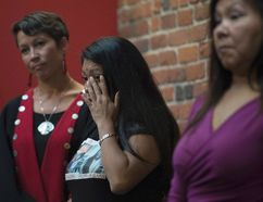 Lorelei Williams wipes a tear from her eye during a news conference on Missing and Murdered Indigenous Women and girls in Vancouver, B.C., Wednesday, August, 3, 2016. THE CANADIAN PRESS/Jonathan Hayward