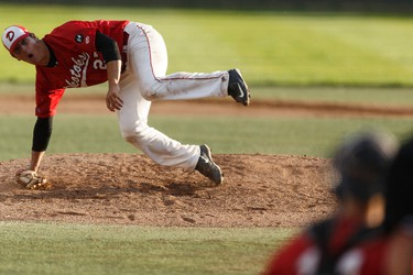 Okotoks' Nick Vickers slips while pitching during Game 4 of the Western Major Baseball League playoff series between the Edmonton Prospects and the Okotoks Dawgs at Telus Field in Edmonton, Alberta on Wednesday, August 3, 2016. Ian Kucerak / Postmedia