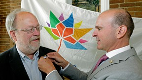 Martin Garber-Conrad receives a pin from Edmonton Centre MP Randy Boisonnault at the Edmonton Community Foundation where celebrations marking the 150th anniversary of Confederation in 2017 kicked off on Thursday, Aug. 4, 2016
