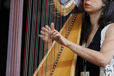 Harpist Sarah Page with The Barr Brothers performs on the main stage during the Edmonton Folk Music Festival at Gallagher Park in Edmonton, Alberta on Thursday, August 4, 2016. Ian Kucerak / Postmedia