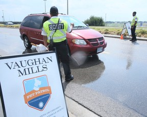 Security check cars as they enter Vaughan Mills on Friday August 5, 2016. Known as Pet Patrol, they make drivers aware of the dangers of leaving pets in their cars while shopping. Veronica Henri/Toronto Sun/Postmedia Network