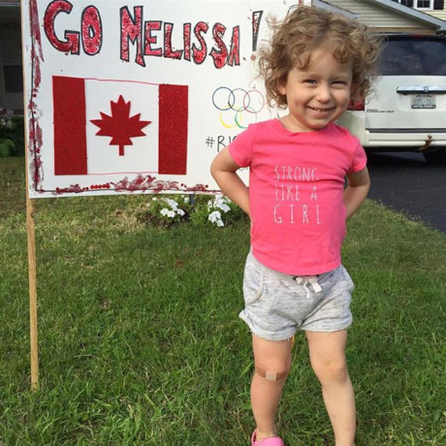 """Photo by Leslie LongAt 2 years old Avalee Long, who lives in Stittsville, loved the seeing the """"Melissa"""" support signs at the entrance to Eganville and wanted to make her own. With help from her mom Leslie who orginally hails from the Barry's Bay area, this is their tribute to Melissa and we think Avalee's shirt """"Strong Like A Girl"""" sums it up nicely! This was submitted to the Team Melissa Bishop Facebook page."""