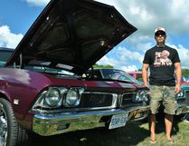 Tom Morrison/The Daily News Mike Abaldo of Tecumseh poses for a photo with his 1960s Pontiac Beaumont at the Bothwell Auto Show in Victoria Park on Saturday.