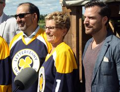 Ontario Premier Kathleen Wynne (middle) wears a Letterkenny jersey and she stands between Sudbury MPP Glenn Thibeault and Mark Montefiore, co-president and executive producer at New Metric Media, following a funding announcement for film and TV projects at the Landry farm in Hanmer, where the hit comedy Letterkenny is filmed. Ben Leeson/The Sudbury Star/Postmedia Network