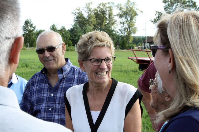 Ontario Premier Kathleen Wynne (middle) talks with the Landry family prior to a funding announcement for film and TV projects at the Landry farm in Hanmer, where the hit comedy Letterkenny is filmed. Ben Leeson/The Sudbury Star/Postmedia Network