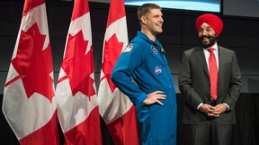 Minister of Innovation, Science and Economic Development Navdeep Bains shares a laugh with Canadian astronaut Jeremy Hansen during an announcement at the Canadian Space Agency, in St-Hubert, Que., on Thursday, Jan. 7, 2016. THE CANADIAN PRESS/Paul Chiasson