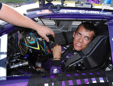 In this Oct. 4, 2007, file photo, Bryan Clauson smiles in his car during qualifying for the ARCA RE/MAX Series 250 auto race, at Talladega Superspeedway in Talladega, Ala. Clauson, considered the top dirt-track racer in the country, has died from injuries suffered in an accident at the Belleville (Kansas) Midget Nationals USAC midget race. He was 27. (AP Photo/Rainier Ehrhardt, File)