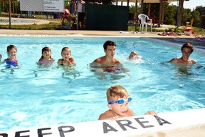 """During the Sea Turtle level swimming lessons led by instructor Thomas Rowland at the Lions Pool in Mitchell Aug. 4, Blake Janssen got to be the shark in a game of """"What time is it Mr. Shark?"""" GALEN SIMMONS MITCHELL ADVOCATE"""