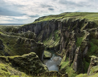 FJAORARGLJUFUR CANYON: This magnificent canyon is about two kilometres long and 100 metres deep and winds its way through bedrock that is thought to be about two million years old. There's a walking trail along the top of the canyon and several waterfalls inside it. The canyon is a short drive off the ring road in south Iceland. (Getty Images)