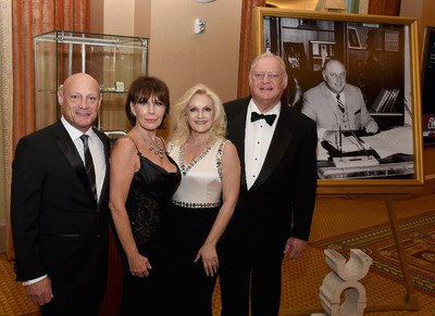 Freddie Sarno, September Sarno, Heidi Sarno Straus and Jay Sarno Jr. pose with a photo of the founder of Caesars Palace Jay Sarno during the 50th anniversary gala at Caesars Palace on August 6, 2016 in Las Vegas, Nevada. Caesars Palace first opened its doors on the Las Vegas Strip on Aug. 5, 1966 and a weekend to celebrate the 50th anniversary of this famed casino resort began a half-century later on Friday, Aug. 5 with an evening pool party for hotel guests at the picturesque Garden of The Gods Pool Oasis. Host Gordon Ramsay led the birthday champagne toast and cake cutting with nearly 3,000 guests. Other celebrity guests during the weekend festivities included Tony Bennett, Howie Mandel, Wayne Newton, Donny & Marie Osmond, and The Righteous Brothers. (Photo by Ethan Miller/Getty Images for Caesars Palace )