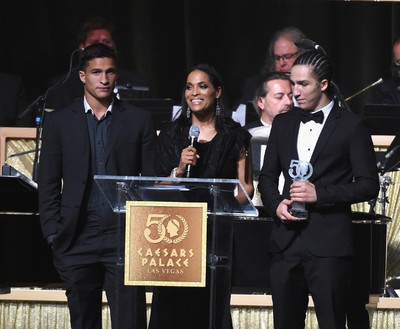 Author Rasheda Ali (C) speaks during the 50th anniversary gala at Caesars Palace on August 6, 2016 in Las Vegas, Nevada. Caesars Palace first opened its doors on the Las Vegas Strip on Aug. 5, 1966 and a weekend to celebrate the 50th anniversary of this famed casino resort began a half-century later on Friday, Aug. 5 with an evening pool party for hotel guests at the picturesque Garden of The Gods Pool Oasis. Host Gordon Ramsay led the birthday champagne toast and cake cutting with nearly 3,000 guests. Other celebrity guests during the weekend festivities included Tony Bennett, Howie Mandel, Wayne Newton, Donny & Marie Osmond, and The Righteous Brothers. (Photo by Ethan Miller/Getty Images for Caesars Palace )