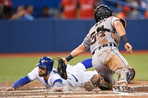 Toronto Blue Jays outfielder Kevin Pillar slides into home plate but is called out as Detroit Tigers catcher James McCann applies the tag in Toronto on Thursday, July 7, 2016. (THE CANADIAN PRESS/Frank Gunn)