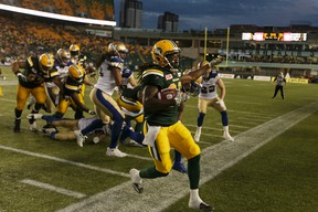 Edmonton's Kenzel Doe (86) runs the ball out of bounds during the second half of a CFL football game between the Edmonton Eskimos and the Winnipeg Blue Bombers at Commonwealth Stadium in Edmonton, on July 28, 2016.