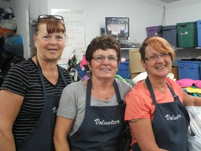 Elaine Gunderson (left), Val Scott and Rosemary Watson of the Friends of Whitecourt society work a shift together at the Repeat Boutique. The organization is celebrating its 50th anniversary and is calling volunteers from around the region to celebrate.