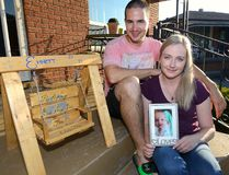 Ashley Lisabeth and Frank Greco show a picture of their son Emmett who died one year ago from myocarditis. The swing was made by a friend of the family for their memory garden. They will be hosting a walk to remember Emmett and raise awareness about myocarditis this weekend. (MORRIS LAMONT/The London Free Press/Postmedia Network)