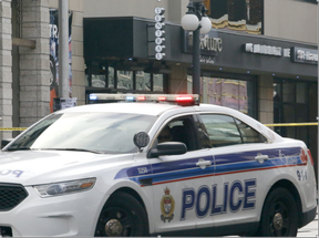 A police car sits in front of businesses on Dalhousie St. in the ByWard Market after a fatal shooting in Ottawa on Sunday, August 14, 2016. (Patrick Doyle, Postmedia)