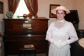 Sombra Museum summer student Taylor Myers strikes a 19th century pose inside the museum's Bury House. CARL HNATYSHYN/SARNIA THIS WEEK