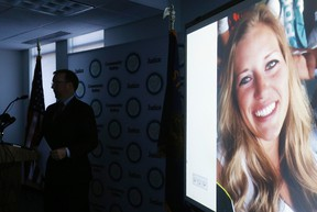 In this July 26, 2016, file photo, a picture of Kaylee Sawyer is displayed on a screen as Deschutes County District Attorney John Hummel speaks during a press conference at the Deschutes County Courthouse in Bend, Ore. The murder of Kaylee Sawyer followed by a string of other crimes leading from Oregon through California allegedly committed by Central Oregon Community College safety officer Edwin Lara has this scenic mountain town deeply shaken. (Joe Kline/The Bulletin via AP, file)