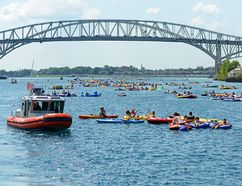 Canadian and United States Coast Guard personnel, emergency responders and law enforcement on both sides of the border are preparing for the unsanctioned marine event known as the Port Huron Float Downs Sunday. Last year, thousands of people gathered to float down the St. Clair River between Port Huron and Marysville, Michigan in inflatable and makeshift rafts. The event has no official organizer and poses significant and unusual hazards given the fast-moving current, large number of participants, lack of life jackets, alcohol consumption, potentially challenging weather conditions, water temperature and limited rescue resources. U.S. Coast Guard photo by Chief Petty Officer Lauren Jorgensen (Handout)