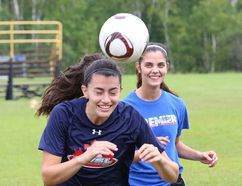 Catherine Rocca, left, and Victoria Galluzzo take part in a drill during a practice for the Laurentian Voyageurs at Laurentian University in Sudbury, Ont. on Tuesday August 16, 2016. John Lappa/Sudbury Star/Postmedia Network