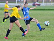 Natasha Brunet, left, McKee Steel Siding and Roofing, gets a pass off past the outstretched foot of Amelia Elliott, of the Dunrite Rubber Wolfpack, during the first half of Game 2 of the Timmins Women's Soccer Club championship series Tuesday night at Timmins High & Vocational School. The Wolfpack posted a 1-0 victory to take the best-of-three series 2-0. THOMAS PERRY/THE DAILY PRESS