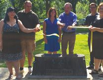 Emma and Andreas Knaub, of Guinn and Simpson Memorial along with artist Yvette Cuthbert, Mayor Irvine Ferris, Steve Hildebrand of the Portage Parks Committee and PCRC's Executive Director Val Garlick cut the ceremonial ribbon at Island Park in Portage la Prairie, unveiling to the public the new benches created by local artsits. (Brian Oliver/The Graphic/Postmedia Network)