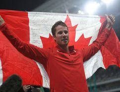 Canada's Derek Drouin celebrates winning the Men's High Jump Final during the athletics event at the Rio 2016 Olympic Games at the Olympic Stadium in Rio de Janeiro on August 16, 2016. / AFP PHOTO / Johannes EISELEJOHANNES EISELE/AFP/Getty Images