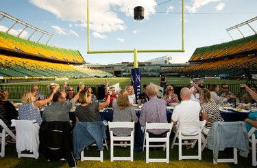 Approximately 400 people enjoy dinner on Commonwealth Field during Feast on the Field, in Edmonton on Wednesday Aug. 17, 2016. Photo by David Bloom