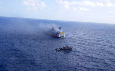 This August 17, 2016 handout photo provided by the Puerto Rico Police Department shows a burning ferry off the U.S. territory of Puerto Rico. (HANDOUT/AFP/Getty Images)