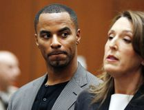 In this Feb. 20, 2014, file photo, Darren Sharper looks toward his attorney, Blair Berk, during an appearance in Los Angeles Superior Court in Los Angeles. Former NFL star Darren Sharper has been sentenced to 18 years and four months in prison in a case where he was accused of drugging and raping as many as 16 women in four states. (AP Photo/Mario Anzuoni, Pool, File)