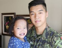 <p>Kris Chung, 21, of Vancouver holds Binh Wagner, 5, at her home in Kingston, Ont. on Thursday, Aug. 18, 2016. Chung donated a portion of his liver to Binh last year for a transplant that saved her life. He is going into his third year at the Royal Military College of Canada . </p><p>Elliot Ferguson/The Whig-Standard/Postmedia Network