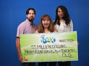 Toronto's Miriam Bueno poses with her novelty cheque from her $55-million Lotto Max win with her son Richard Streit and daughter Diana Aldama in this OLG handout photo.
