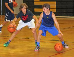 Ben Huckabone, left, and Michael Plazek practice during one of the sessions held by the Ottawa Valley Basketball Academy at Fellowes High School Friday afternoon. The annual clinic helps players sharpen their skills before the upcoming season.