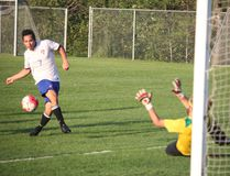 Logan Mejia of the Cornerstone Playaz puts a shot just past a diving Nate Goss in the Centuries net, and just past the post in Thursday's Challenge Cup semifinal game which the Playaz won 5-0. LLOYD MACK/Daily Miner and News