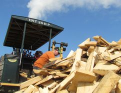Jeff Searson of Sarnia, loads wood Friday August 19, 2016 in Forest, Ont., on a steam engine dating from 1917. It is on display this weekend at the Western Ontario Steam Threshers 59th Annual Steam Show at the Forest Fairgrounds. Paul Morden/Sarnia Observer/Postmedia Network
