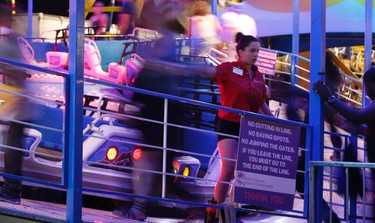 Directing riders onto the Polar Express on Opening Night at the 138th edition of the CNE on Friday August 19, 2016. Jack Boland/Toronto Sun/Postmedia Network