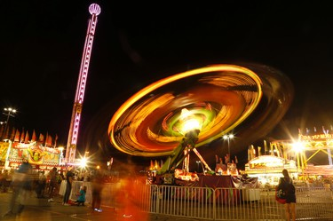 The spinning wheel on Opening Night at the 138th edition of the CNE on Friday August 19, 2016. Jack Boland/Toronto Sun/Postmedia Network