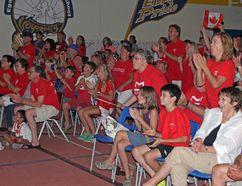 Supporters of runner Melissa Bishop gathered at the Eganville and District Public School Saturday night watch and cheer as she enters the home stretch in the 800 m final. Bishop would miss being on the podium by fractions of a second, finishing fourth overall.