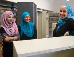Maryium Mansur, 14, and Ayah Barghout, 14, and vice-principal Sally Kaloti check out the future site of the library at Al-Taqwa Academy's new home in the former Sir Winston Churchill elementary school. (MIKE HENSEN, The London Free Press)