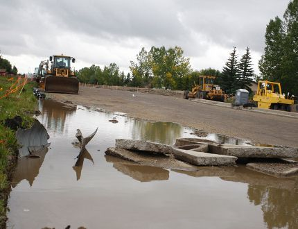Work on 68 Avenue appears to be stalled as water pools along the road under construction on Monday August 22, 2016 in Grande Prairie, Alta following the heavy weekend rains. For the second time this month, parts of Grande Prairie flooded leaving some ditches carrying large volumes of water and large puddles throughout the area. Jocelyn Turner/Grande Prairie Daily Herald-Tribune/Postmedia Network