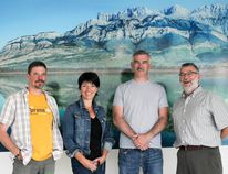 Giles Merriott, Lana Kirtley, Lockyer Mercer and Julian Buchwald pose in front of Mercer's photo of Jasper's Talbot Lake. The photo is displayed outside of Surgical Services. (Chris Funston/Edson Leader)