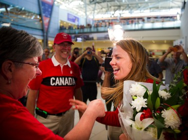 Gold medalist Erica Wiebe goes to hug her mother Paula Preston after returning from the Olympics in Rio to Ottawa at the Ottawa Macdonald�Cartier International Airport Tuesday August 23, 2016.  Photos by Ashley Fraser