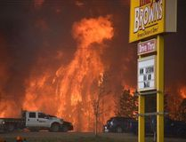 A wall of fire rages outside of Fort McMurray on Tuesday May 3, 2016.