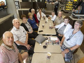 Clockwise from bottom left, Tony Van Kessel, Bill Doucet, Inez Crowe, Joanne Doucet, Harry Fitzsimmons, Terry Shouldice, Elizabeth MacFarlane, Peter Crowe, Jean Elder and Pat Osborne are all members of an informal breakfast club that meets almost daily at the South Keys McDonald's. BRUCE DEACHMAN/POSTMEDIA